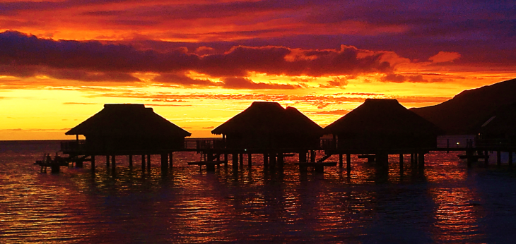 over water bungalows sunrise