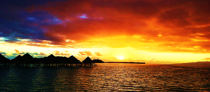 overwater bungalow sunrise