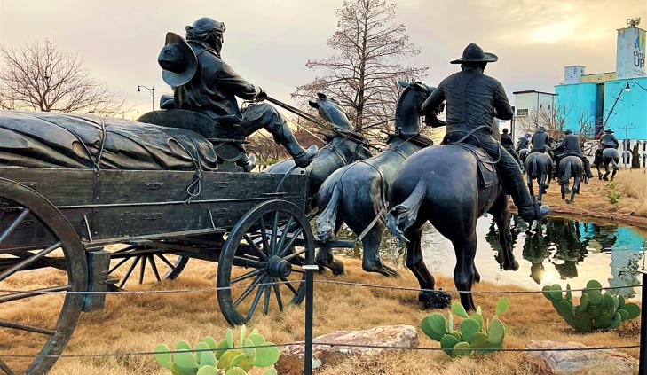 land run monument statue